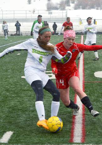 Freshman Summit midfielder Grace Karoly tries to pull the ball away from a Steamboat Springs defender at a home varsity soccer game on March 29. The Tigerslost, 0-2.