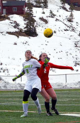Air ball: Summit senior midfielder Katie Sullivan jockeys with a Steamboat Springs player for a header at a home soccer game just before spring break, shot by @sumcosports