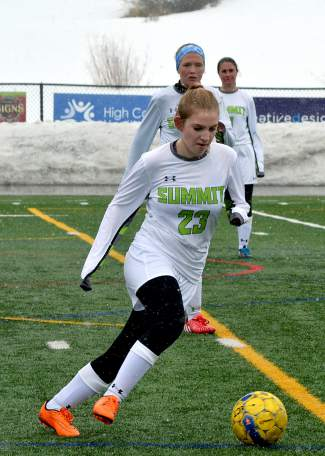 Young blood: Summit freshman Syd Frolik takes touches down the field at a home varsity soccer game against Steamboat Springs on March 29, captured by @sumcosports