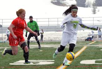 Summit senior forward Paloma Arredondo takes the ball deep into Steamboat Springs territory during a varsity soccer game at home on March 29. The Tigers lost, 0-2.