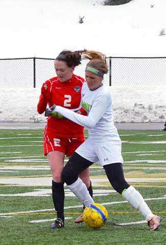 Summit's Haliegh Lecklitner trades bumps with a Steamboat Springs defender during a home varsity soccer game on March 29. The Tigers lost, 0-2.