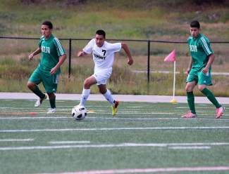 Junior Alex Veleta goes for the ball during Summit's 1-0 loss to Delta Saturday.