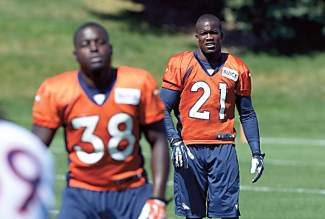 ENGLEWOOD, CO - AUGUST 26: Denver Broncos running back Montee Ball (38) and Denver Broncos running back Ronnie Hillman (21) stretch before practice  August 126, 2013 at Dove Valley. (Photo by John Leyba/The Denver Post)
