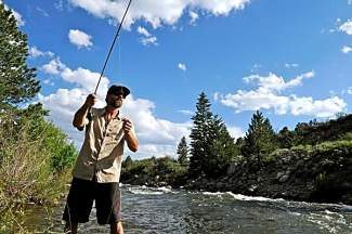 Phil Porter of Minturn fishes for his dinner on the upper Arkansas River near Buena Vista in June 2013. Earlier this year, a 102-mile segment of the Upper Arkansas was given Gold Medal status by Colorado Parks and Wildlife, which worried some anglers about stricter fishing regulations. CPW officials announced this week regulations have not changed.