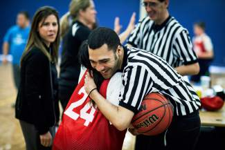Good times on the hardcourt: An athlete hugs a ref between games at the Special Olympics Colorado State Basketball Tournament on March 12 in Littleton, captured by photog Kent Meireis