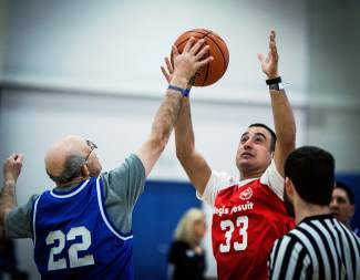 And...play! Adult athletes tip off during a game at the Special Olympics Colorado State Basketball Tournament in Lakewood on March 12, captured by photographer Kent Meireis