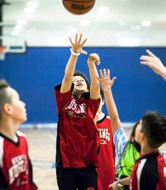 And one: A youth player at the 2016 Special Olympics Colorado State Basketball tournament takes a shot during pratice before a game in Littleton on March 12, captured by photographer Kent Meireis