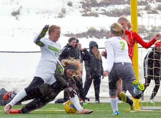 Heated in the box: Summit attackers descend on the ball after a corner kick in the final 10 minutes of a home varsity game against Steamboat Springs on March 29, captured by @sumcosports