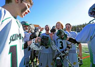 Fired up: The Summit varsity boy's lacrosse team gets fired up before the start of the second half against Eagle Valley April 6, captured by @louietraub