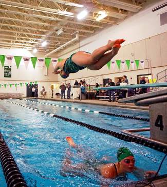 A Summit swim team members takes off from the blocks during the medley relay at a dual meet against Conifer on Jan. 12 at home. The Tigers A team finished in second (2:16.11) behind Conifer's A team (2:06.11).