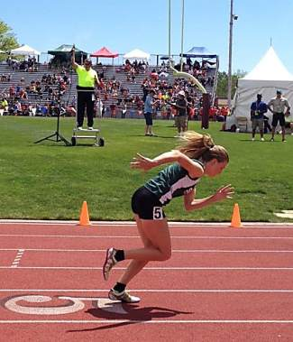 Summit senior track star McKenna Ramsay explodes off the start line for the 400m dash at the 2016 4A State Track and Field Championships in Lakewood on May 19. Ramsay qualified for the finals today, all while breaking a personal best and all-time Summit High School record.