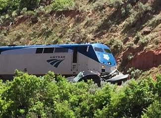 The pickup truck struck by Amtrak's westbound California Zephyr is visible in the lower right of this photo. The truck cab, which is in front of the train engine, appears to be mostly intact, with the bed of the truck crushed by the nose of the train engine.