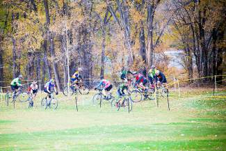 Little Salt Wash hosts a cyclocross race, as riders wind through an obstacle.