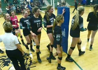 The Tigers switch courts after winning the first set of a varsity volleyball match against Battle Mountain at home on Oct. 20. The Tigers lost 3-1.