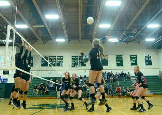 The Tigers fight for a point in the third set of a varsity volleyball game against Battle Mountain at home on Oct. 20. The Tigers lost 3-1.