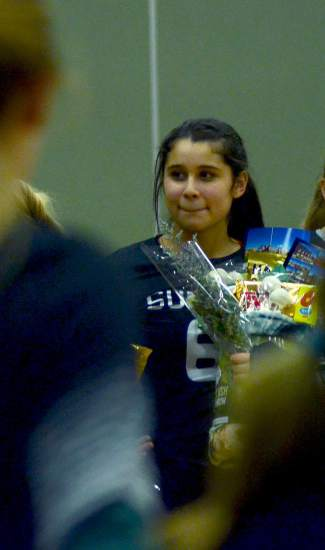 Summit's Michelle Frias holds got flowers from her teammates before playing the final (yes, final) Huskies rivalry game of her career on senior night, shot by @sumcosports