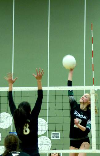 Summit's Emily Wallace (3) goes for a kill in the third set of a varsity volleyball match against cross-county rivals Battle Mountain at home on Oct. 20. The Tigers lost 3-1