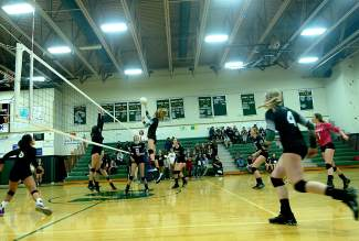 The Tigers take a volley in the third set of a varsity volleyball game against Battle Mountain at home on Oct. 20. The Tigers lost 3-1.