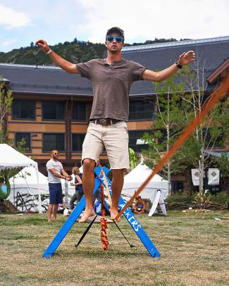 Forrest Williams, of Denver, practices his slacklining skills between classes on July 6.