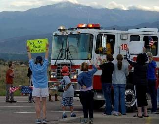 BLACK FOREST, CO - JUNE 16:  Hundreds of Colorado Springs and area residents turned out at the corner of Old Ranch Road and Thunder Mountain Road outside of the Black Forest Fire Incident Command Post to cheer on firefighters and law enforcement officials as they come off of the fire line for the evening on June 16, 2013. The command post is set up at Pine Creek High School. The fire is currently 65% contained.  Photo by Helen H. Richardson/The Denver Post)