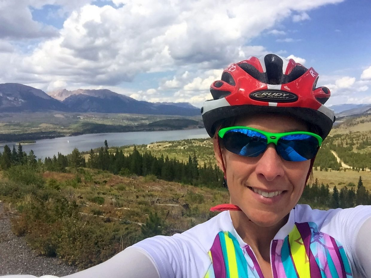 Silverthorne local Candy Elkind stops for a selfie at the top of Swan Mountain Road during a training ride in early September. Since January, the 46-year-old has been riding and running at altitudes above 9,000 feet to prepare for her hometown Ironman, the 106 West Triathlon, which debuts Sept. 10 with a swim on Lake Dillon, ride to Montezuma and run to Frisco.