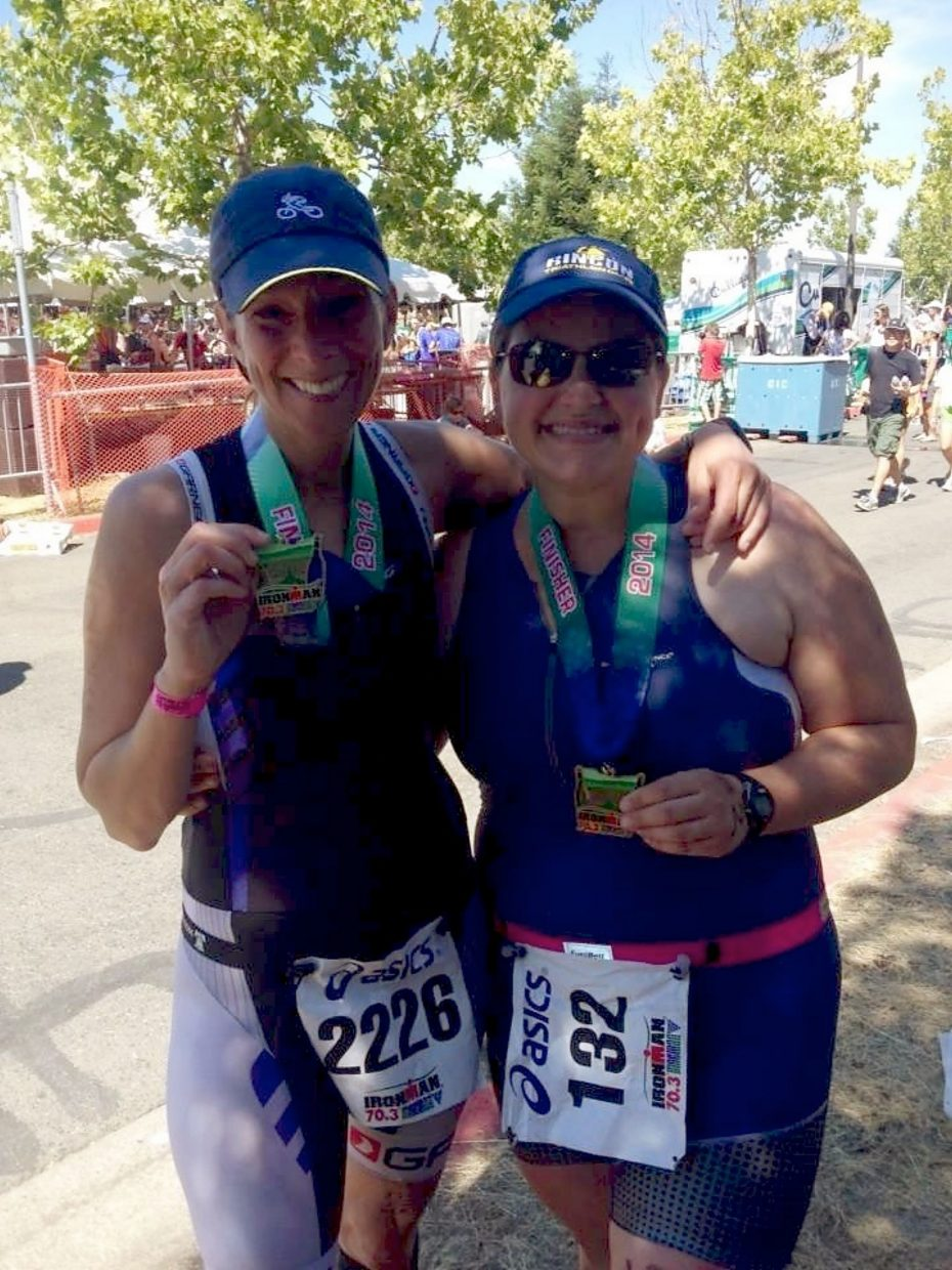 Summit local Candy Elkind (left) after finishing the Vineman 70.3 Ironman in July 2014. The 46-year-old Philadelphia native moved to Summit County in 2013 and couldn't pass up the chance to tackle her hometown Ironman, the 106 West Triathlon on Sept. 10.