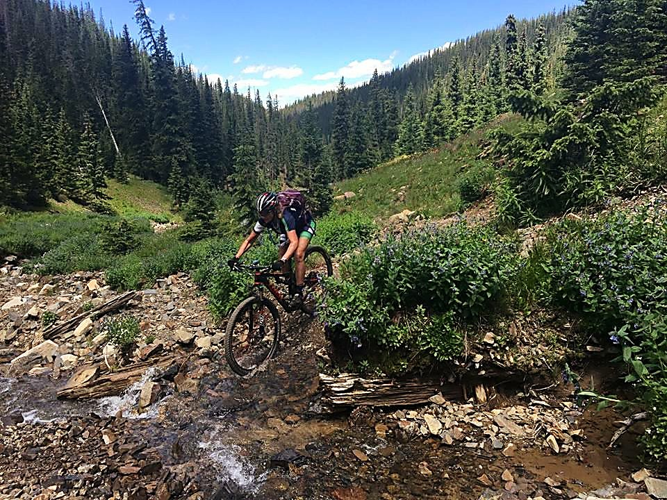 Elite Alabam mountain biker Grace Ragland crosses a creek during a ride in Colorado. The 55-year-old with multiple sclerosis comes to Summit County this weekend for her first attempt of the Copper Triangle, a 79-mile road ride over three classic passes: Fremont Pass, Tennessee Pass and Vail Pass.