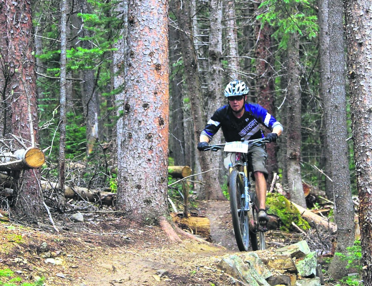 A competitor powers through the trees during the 2016 Fall Classic mountain bike race on Sept. 4, the final event of the summer-long Summit Mountain Challenge series. The event drew about 200 total riders for a 30-mile long course and 21-mile short course.