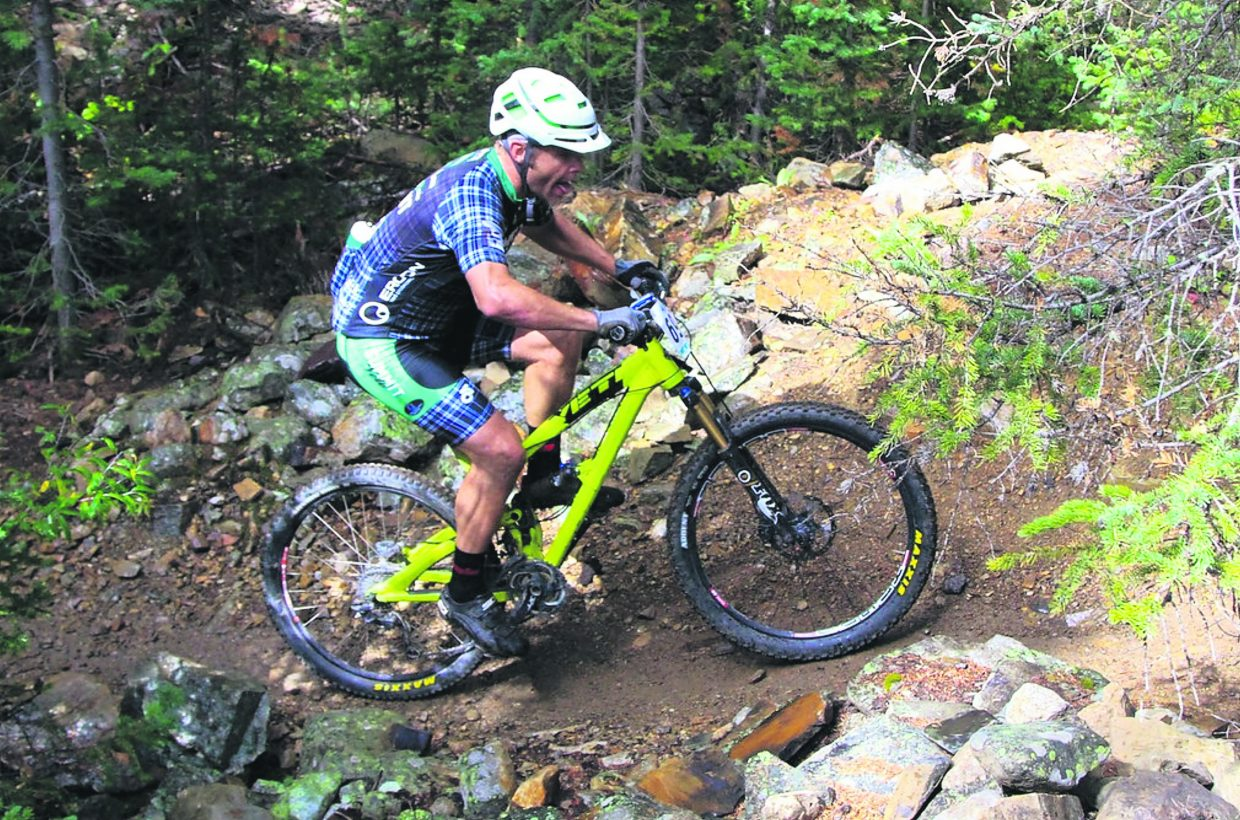 A competitor huffs up one of several climbs during the 2016 Fall Classic mountain bike race on Sept. 4, the final event of the summer-long Summit Mountain Challenge series. The event drew about 200 total riders for a 30-mile long course and 21-mile short course.