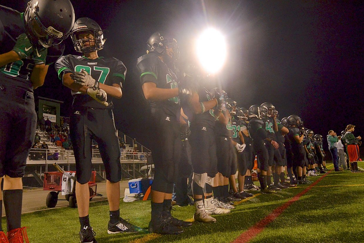 The Summit High varsity football team on the sidelines at the first home game of the season against Niwot on Sept. 9. The Tigers take on Clear Creek today for the homecoming game at Tigers Stadium. Kickoff is at 6 p.m.