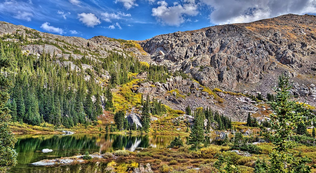 Special to the WeeklyLake Constantine and the rugged mountainside in the Holy Cross Wilderness. While most local hikes feature jagged, unfriendly rock, this area in the Holy Cross Wilderness is speckled with large slabs of marble-like smooth rock.