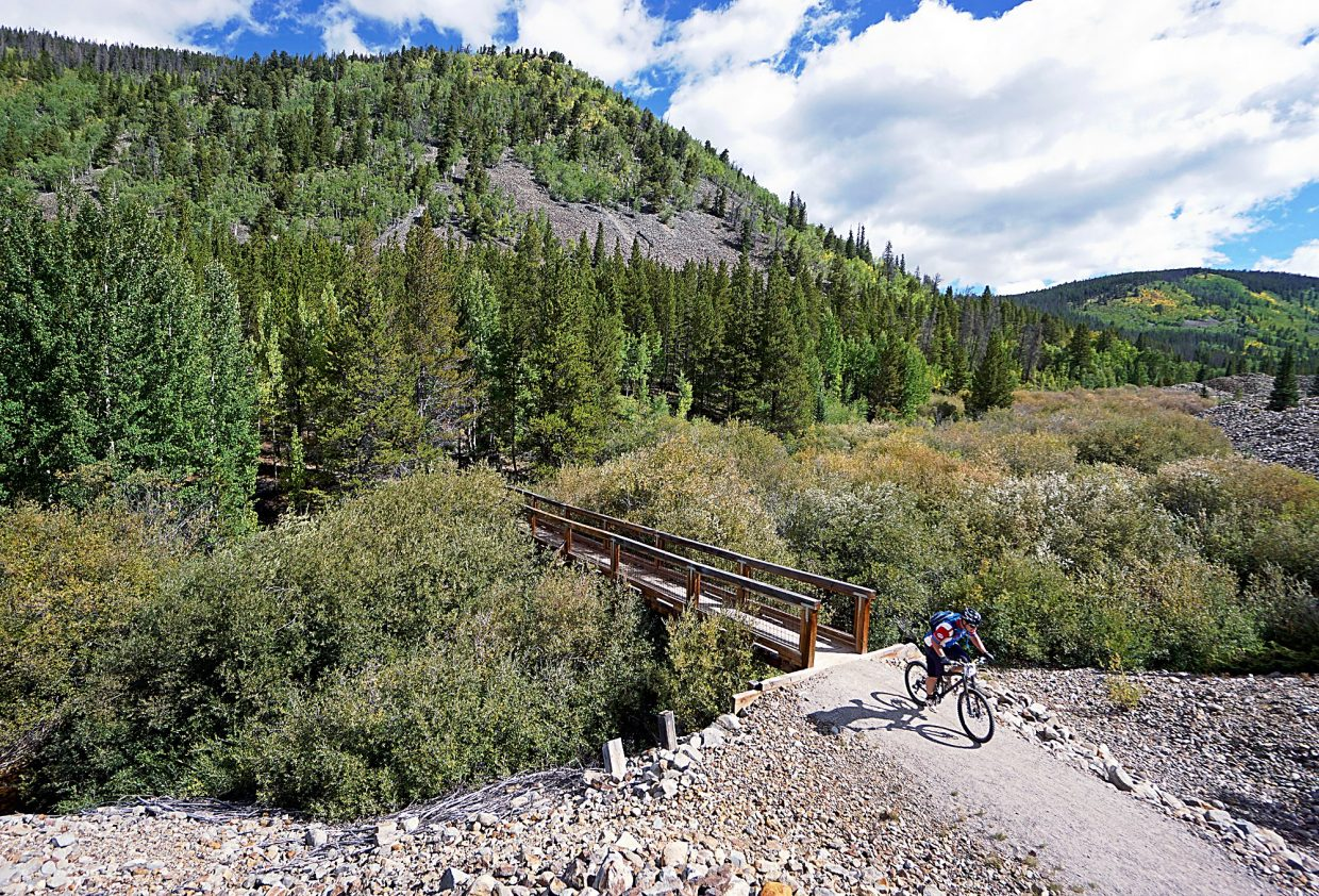 A racer crosses French Creek during the 2015 Fall Classic mountain bike race in Breckenridge. The ride has changed little since its early days in the '80s during the first big mountain-biking boom and returns this year on Sept. 4.