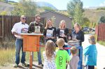 Local authors gathered to donate books to Silverthorne's Little Free Library by the post office. Each author is holding up their book, from left Johnny Welsh, Richard M. Brock, Jaci Ohayon, Karin Mitchell (cutting the ribbon) and Susan Schulman.