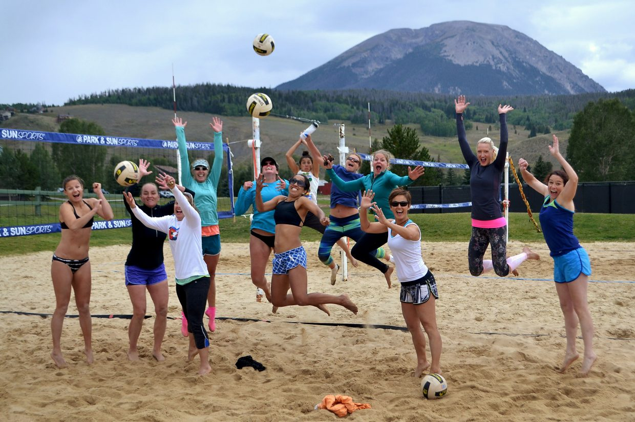 Ladies catch air at the 2016 Queen of the Beach volleyball tournament on Aug. 28 in Silverthorne.