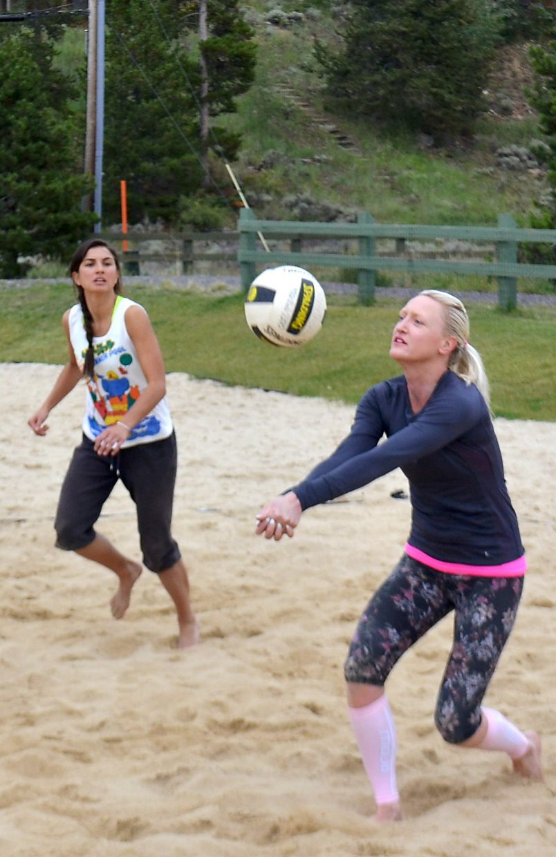 Erika Solm (right) rallies with Queen of the Beach winner Aurora Santos. Santos earned her crown in a rainy final match against second place finisher Solm and her partner, Kamila Taylor.