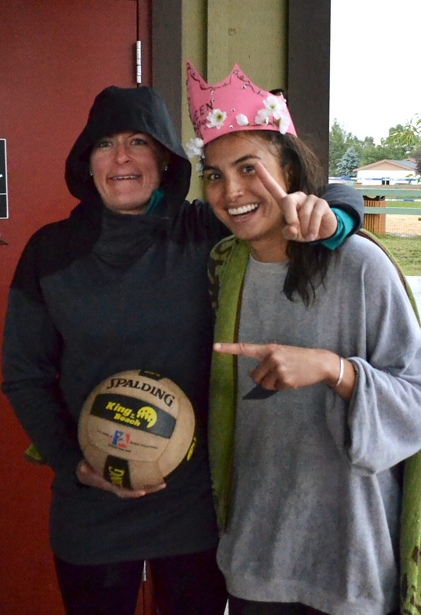 Queen of the Beach: 2016 winner Aurora Santos gets away from the rain after winning the annual sand volleyball tournament on Aug. 28 in Silverthorne.