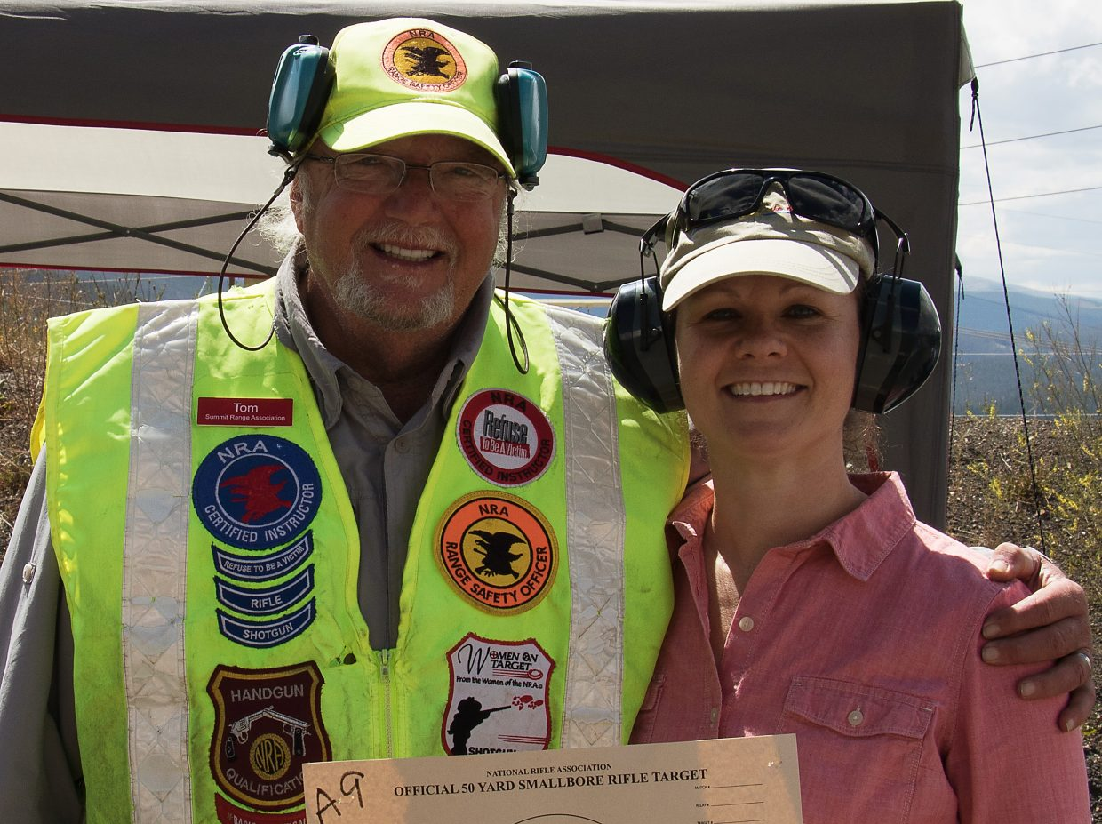 Local real estate agent Kristin Walter with range officer Tom Little after she won the 2016 Rimfire Challenge at the Summit County Shooting Range on Aug. 27.
