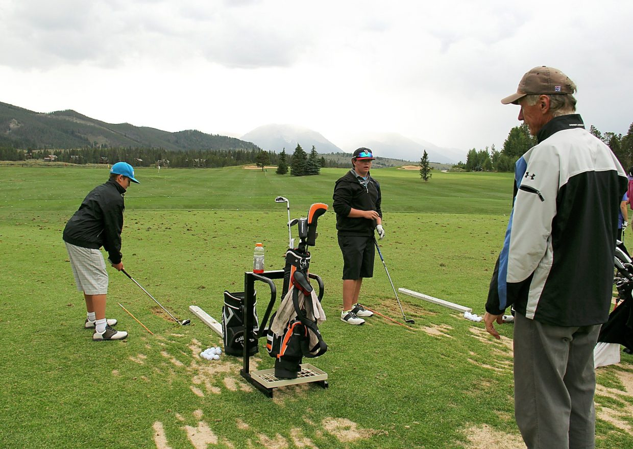 Summit High School golf coach Gary Sorensen looks on as Graham Gaspard and Keegan Cancelosi practice on the range at the Keystone Ranch Golf Course earlier in his career.