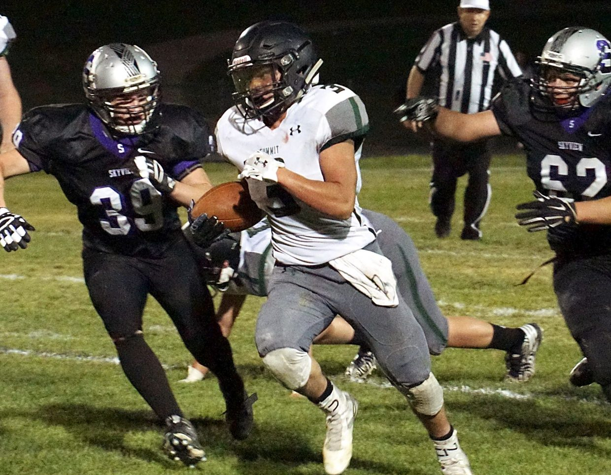 Tigers senior running back Adolfo Vasquez tears past Skyview defenders at an away football game on Sept. 16. The Tigers lost, 33-14.