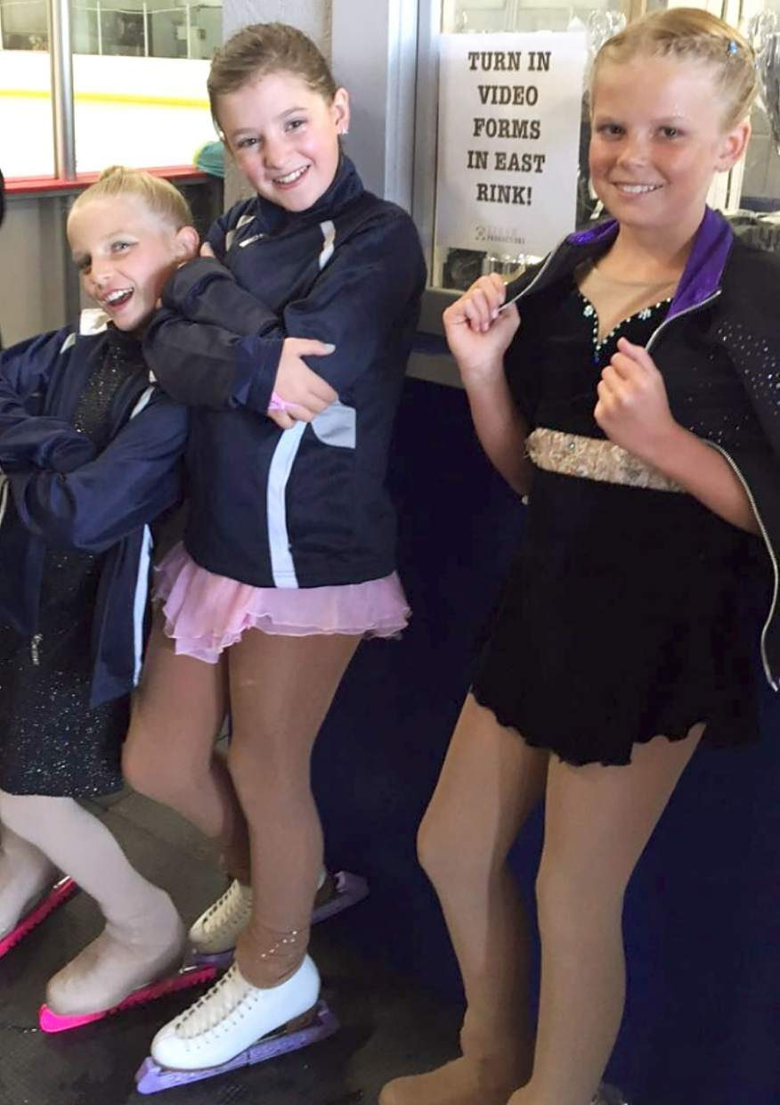 Local figure skating trio (from left) Graciejane Cole of Fairplay, Jennifer Stevens of Leadville and Taylor Perry of Breckenridge get ready for their first-ever skating competition in Colorado Springs on Sept. 11. All three finished the weekend with medals for choreographed performances to music.