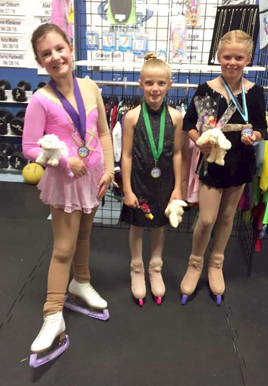 Local figure skating trio (from left) Jennifer Stevens of Leadville, Graciejane Cole of Fairplay and Taylor Perry of Breckenridge show of the hardware after winning medals at their first-ever skating competition in Colorado Springs on Sept. 11.