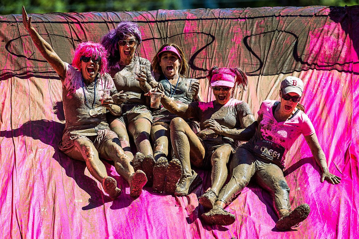 A group links up to slide down the muddy inflatable slide at last year's Dirty Girl Mud Run at Copper Mountain. The fun run returns on Sept. 10 as part of the Unleash the Fierce weekend, with indoor and outdoor events made just for ladies.