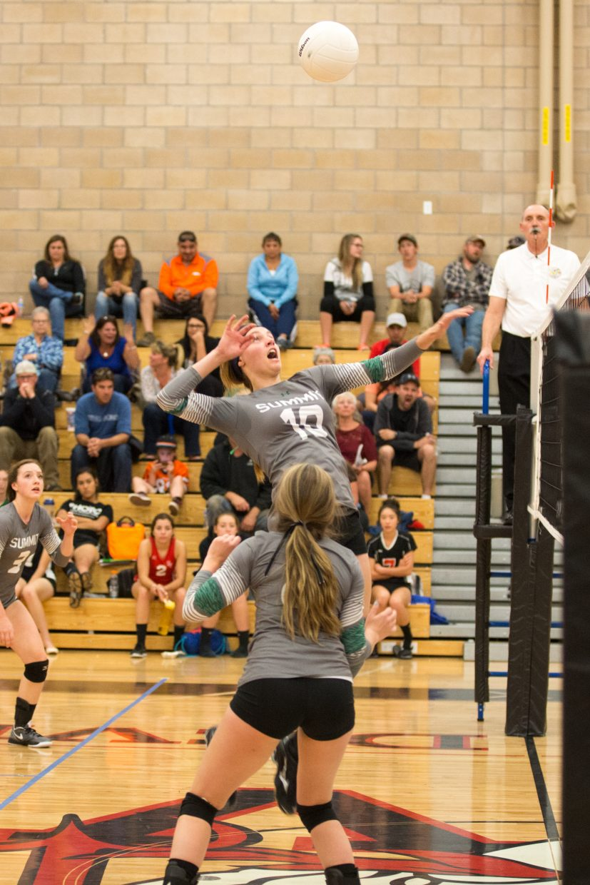 Summit County senior Sam Buer attacks at the net against Eagle Valley on Thursday night in Gypsum. The Tigers fell to the Devils in three and host West Grand on Tuesday.