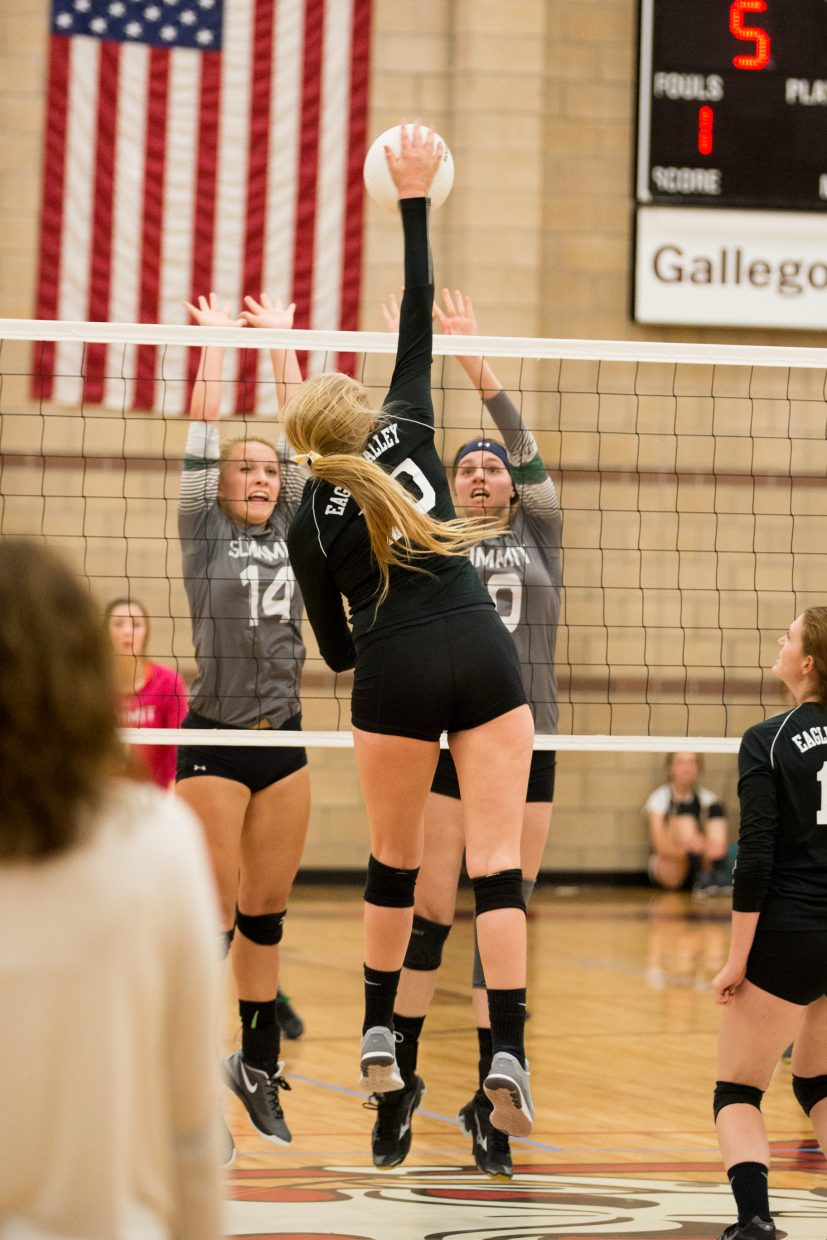 Kylie Martin fires away against Summit County during the Devils' three-set win over the Tigers. Martin, a senior, has changed positions this year from middle blocker to outside hitter.