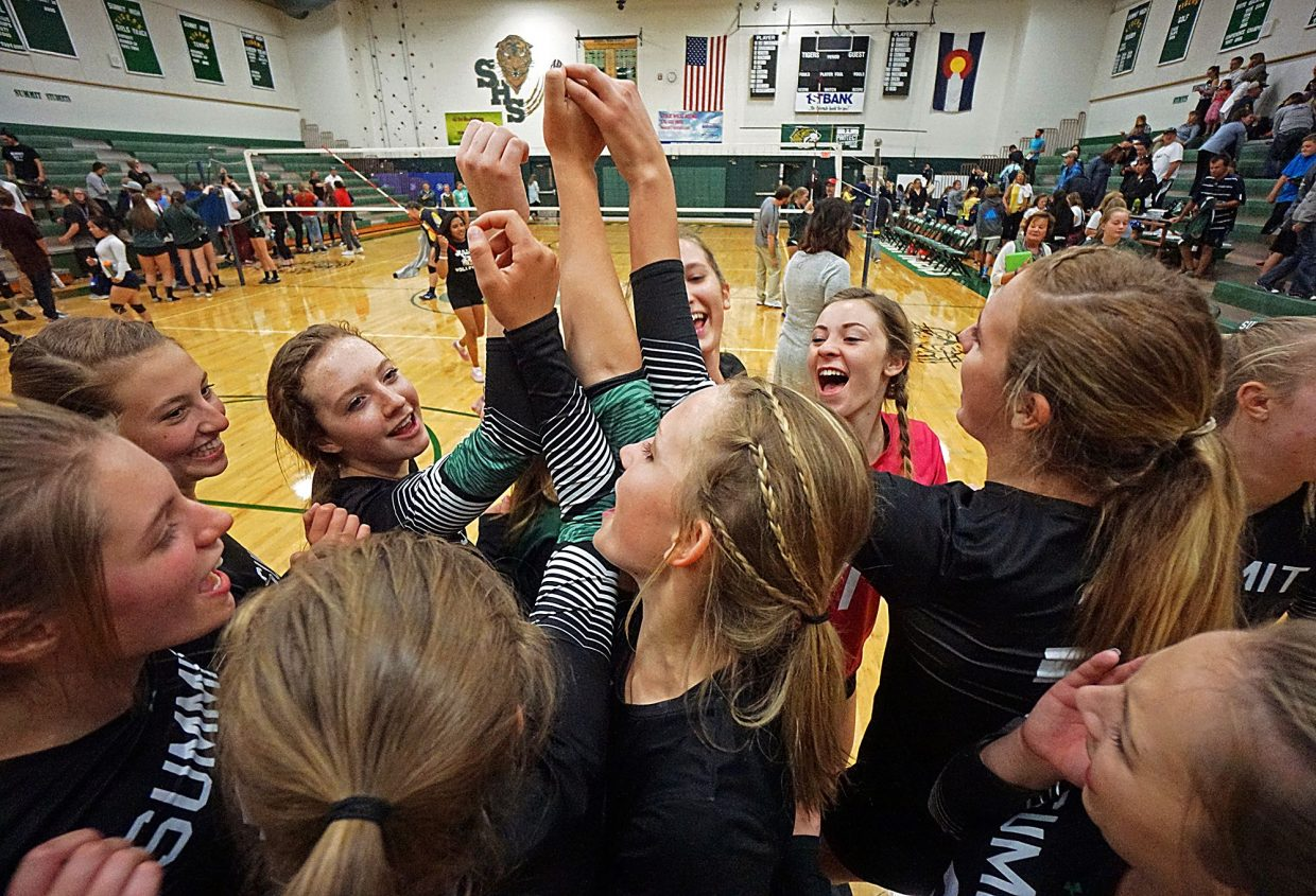 The Summit High girl's varsity volleyball team gathers on the court to celebrate following their 3-0 win over Rifle on Sept. 6. The team is now 2-0 for the season on the strength and relies on a well-balanced team of sophomores, juniors and just three seniors.