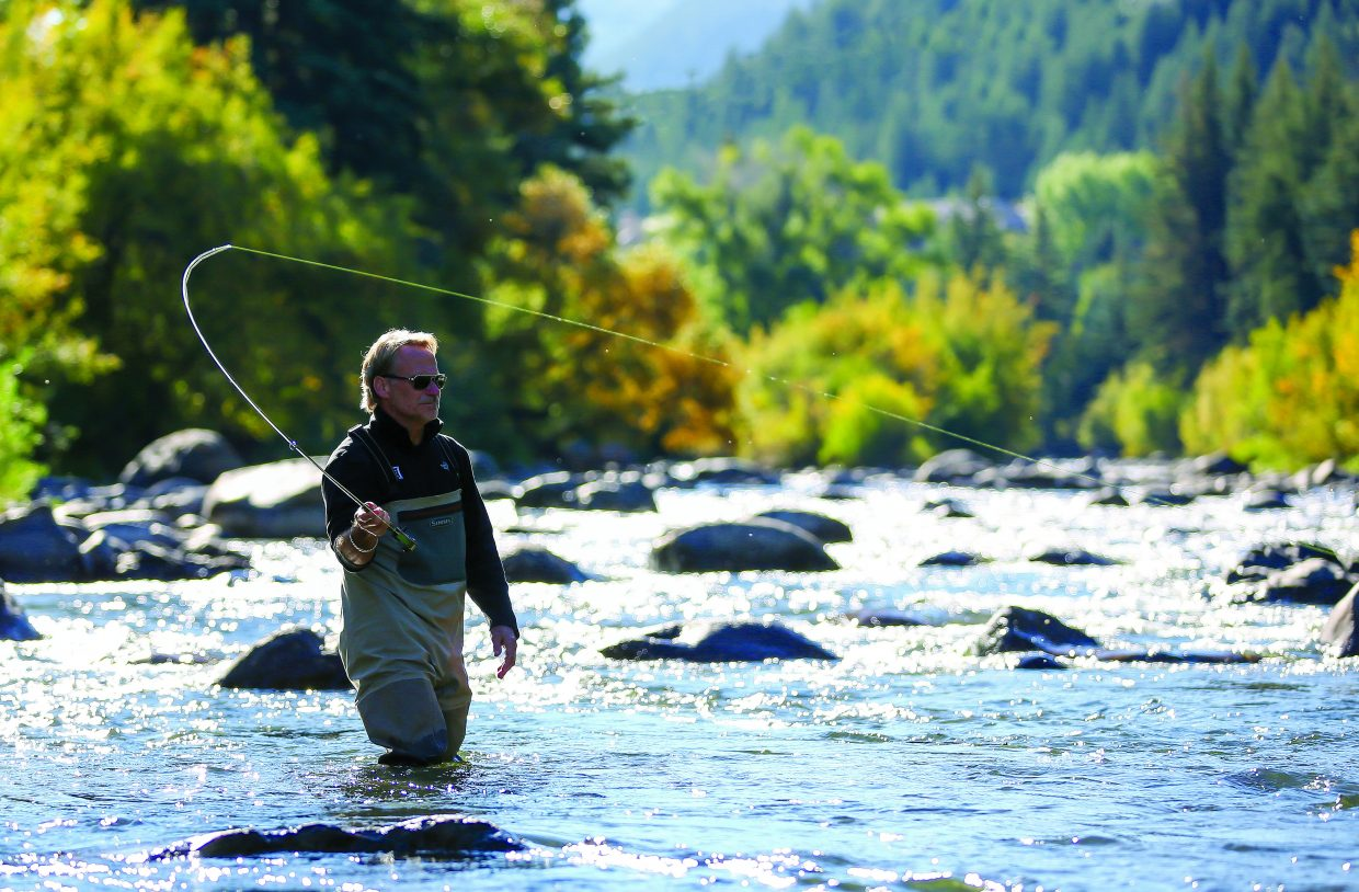 Beginner fly-fisherman Steven Kempf casts his line across a slow-moving section of the Eagle River in Avon during a wade trip with his wife, Patti, guided by Mike Gilser of Gore Creek Fly Fisherman. The World Fly Fishing Championships comes to the Eagle River and several other Eagle County waterways from Sept. 11-18.