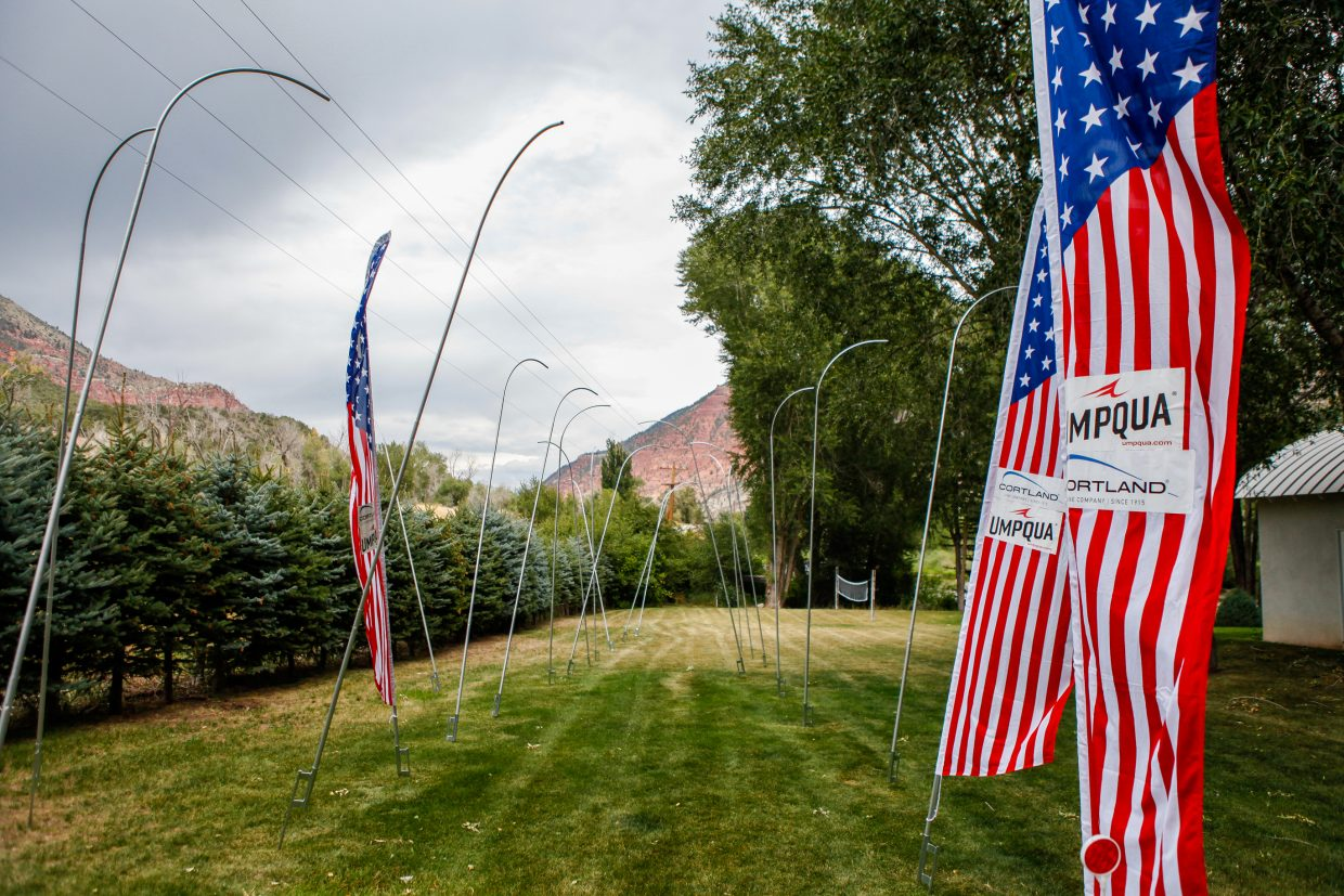 Flags and poles sit waiting to be used at John Knight's house Monday in Eagle. The flags will be used to mark fishing spots during the World Fly Fishing Championships beginning Sept. 11.