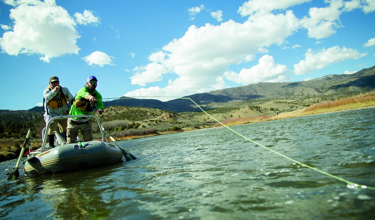 """A fly-fishing guide coaches a student on where to cast his line into a """"hole"""" on a section of the upper Colorado River. The World Fly Fishing Championships comes to the Colorado River and several other Eagle County waterways from Sept. 11-18."""