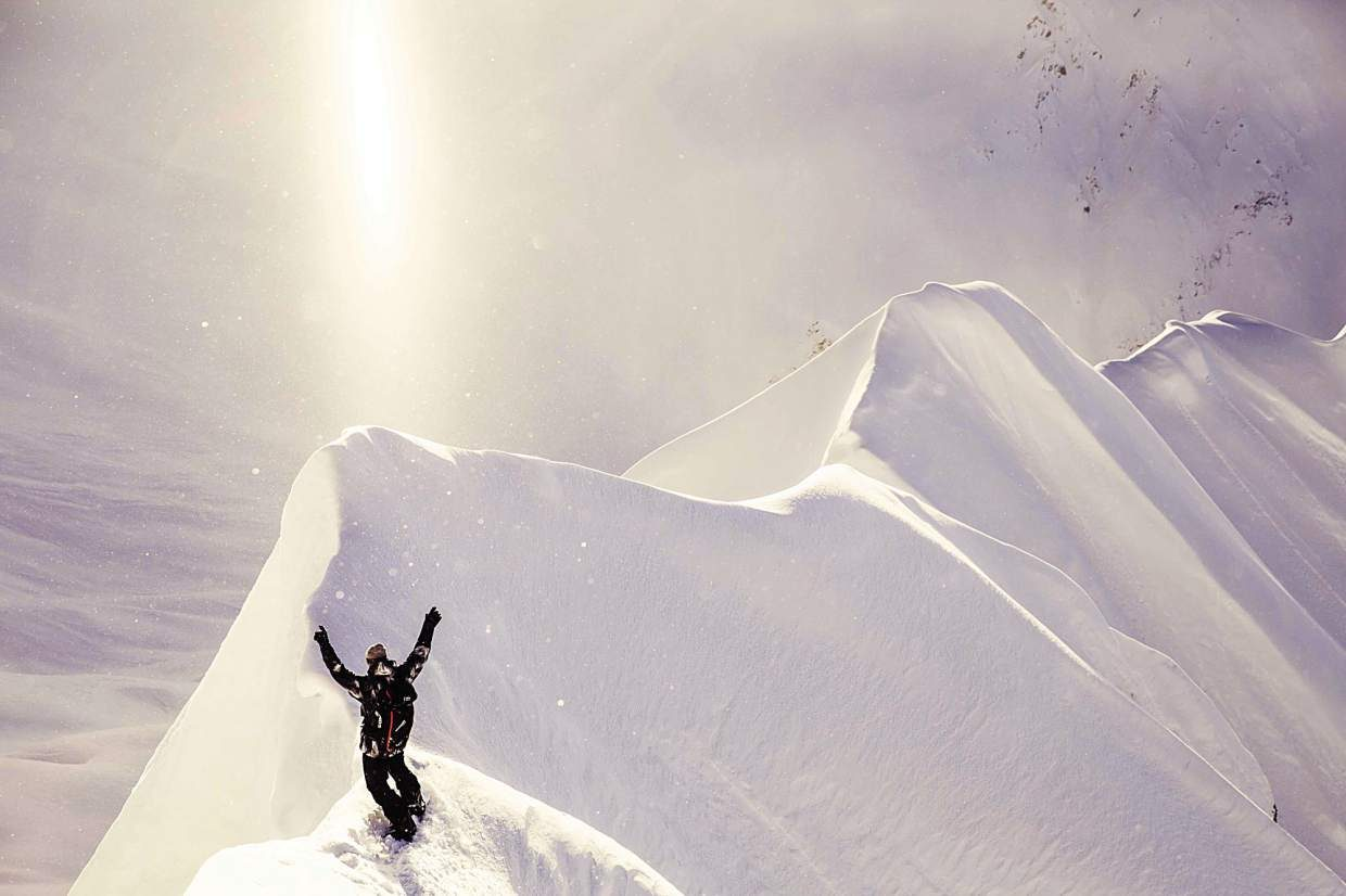 Travis Rice on a ridge in Alaska during filming for