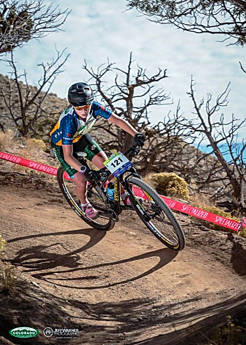 Summit's Ezra Smith whips through a berm on the Haymaker mountain bike course in Eagle during the Colorado High School Cycling League State Championships on Oct. 24. Smith took first over Salida's Harper Powell by 0.4 seconds to become state champion and looks to defend her title this season when the Tigers MTB team moves to Division I, the highest division for high school racing in the state.